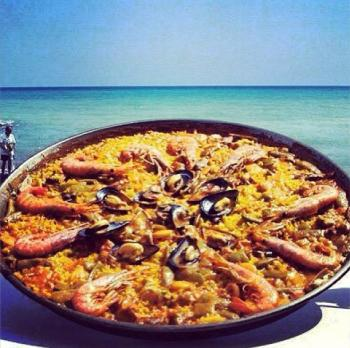 A mouthwatering dish of one of our chef's specialties, Paella. Yum!