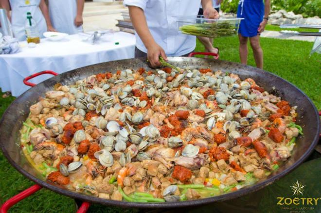 How delicious does this savory paella look? It's prepared with fresh-caught seafood, including clams and shrimp.