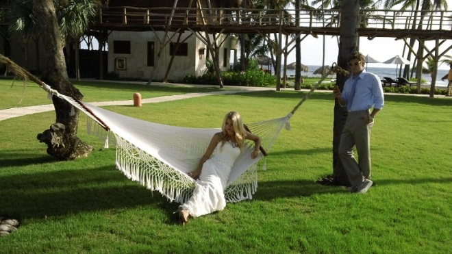 The bride rests on the hammock while the groom instagrams a photo of his beautiful bride. What's not to love about this photo?!