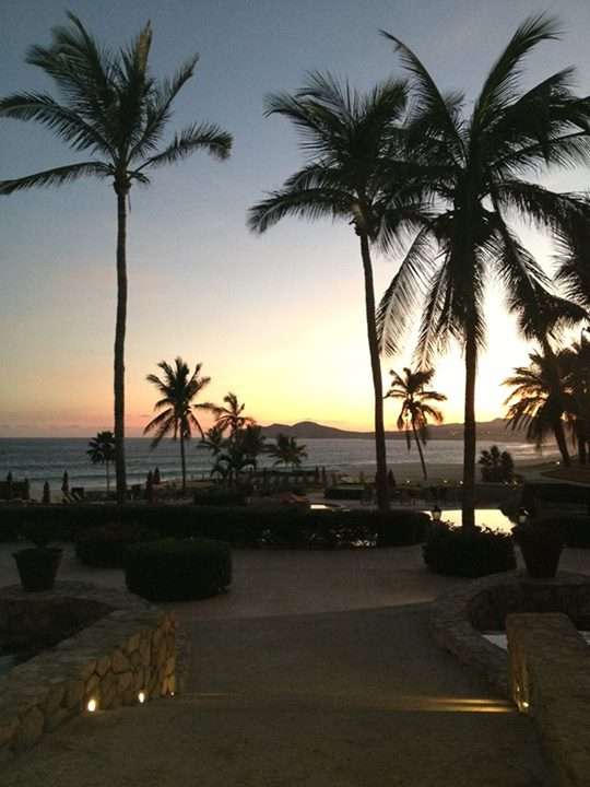 A look down the back walkway at Zoëtry Casa Del Mar Los Cabos reveals a lovely sunset.