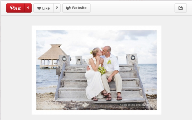 Loving the flip flops on this happy beach couple. What a beautiful shot!