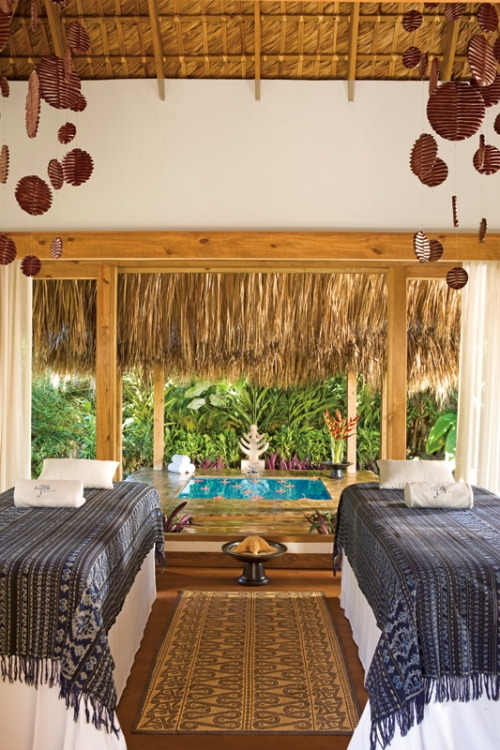 An open-air treatment cabin provides couples with a tranquil and rejuvenating spa experience.