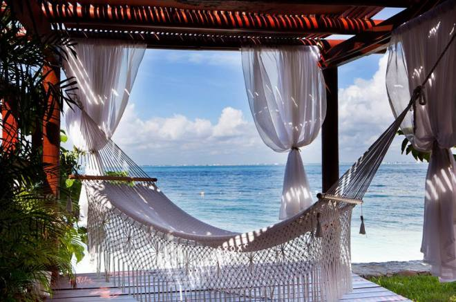 Enjoy the light, tropical breeze as you lay on your hammock by the Caribbean Sea at Zoëtry Villa Rolandi Isla Mujeres.