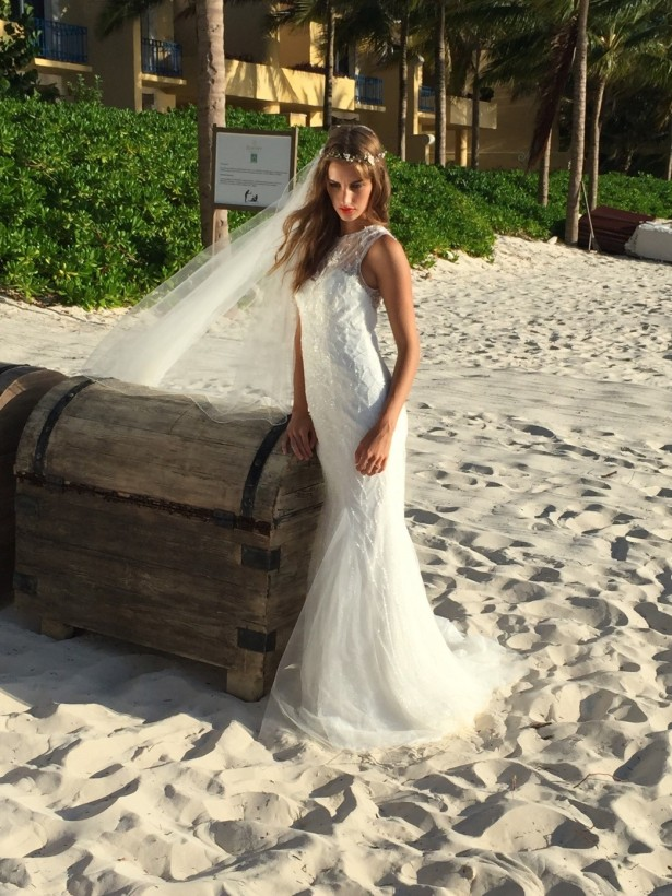 Lush greenery, golden sands and wooden chests accentuates the gown by using nature and rustic elements.
