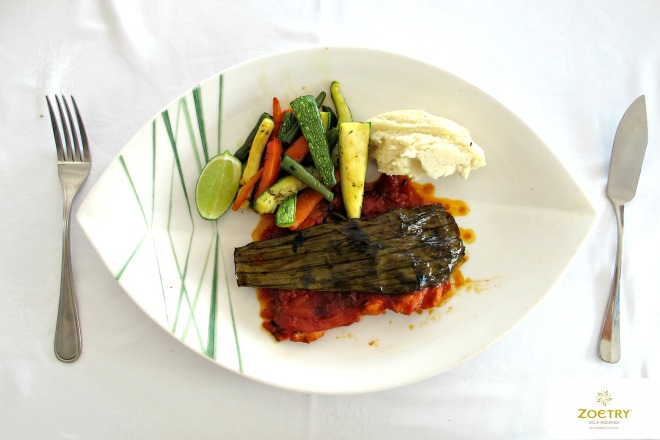 A Viernes - Fish Fillet prepared with butter and a special Mayan sauce with achiote, (e)