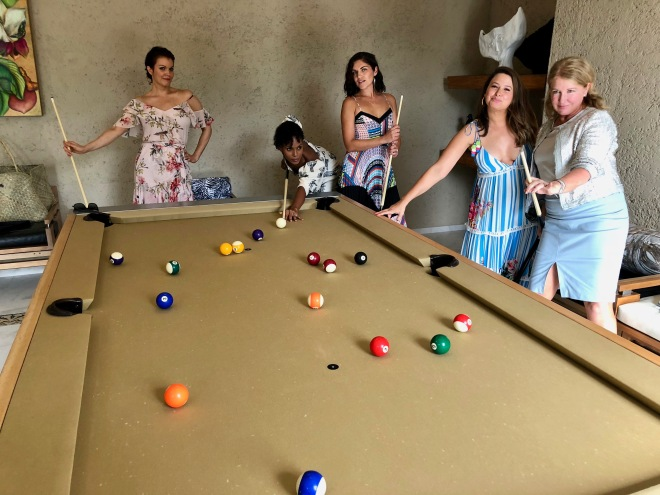 6 Girls playing pool